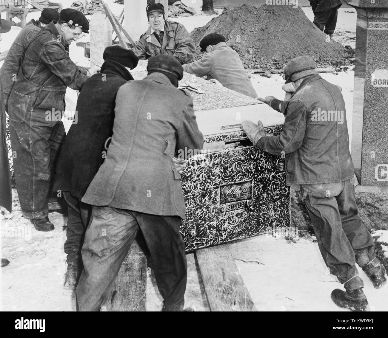 Burying Al Capone. Workmen at Mt. Olivet Cemetery in Chicago moving the vault with Al Capone's body. Feb. 6, 1947. Stock Photo
