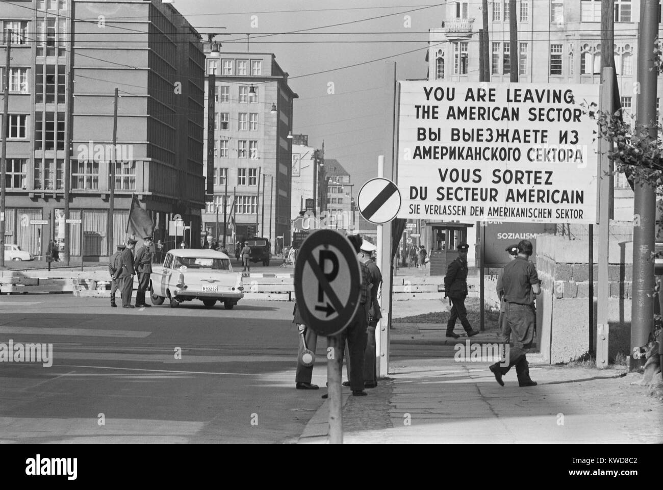 Border checkpoint in West Berlin, with sign 'You are leaving the American Sector' in four languages. October - Stock Image