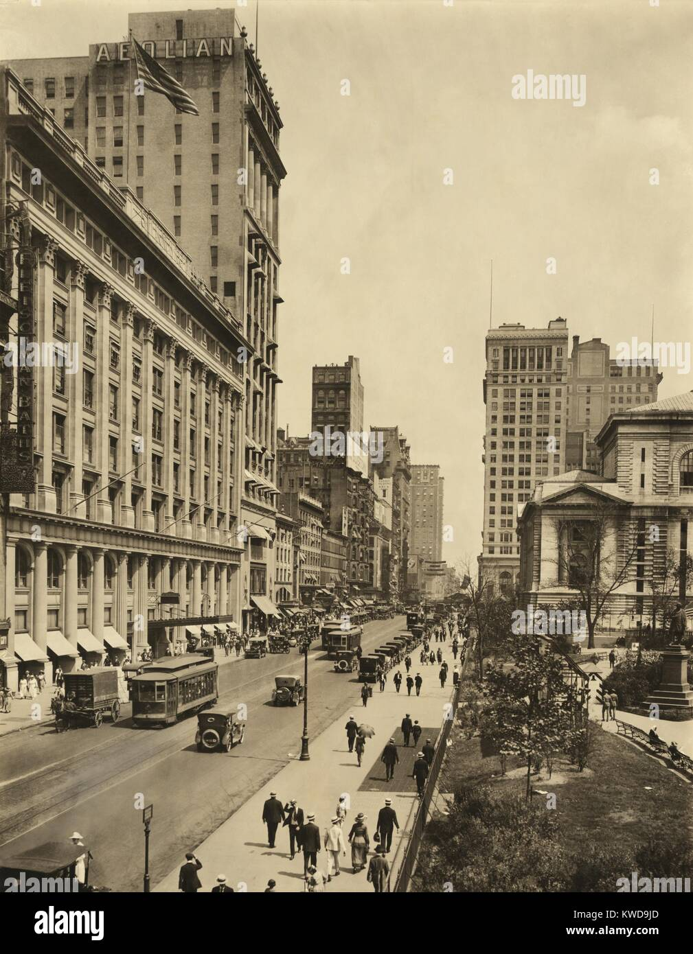 New York City's 42nd St. looking east from 6th Avenue. On right is the New York Public Library and Bryant Park, - Stock Image