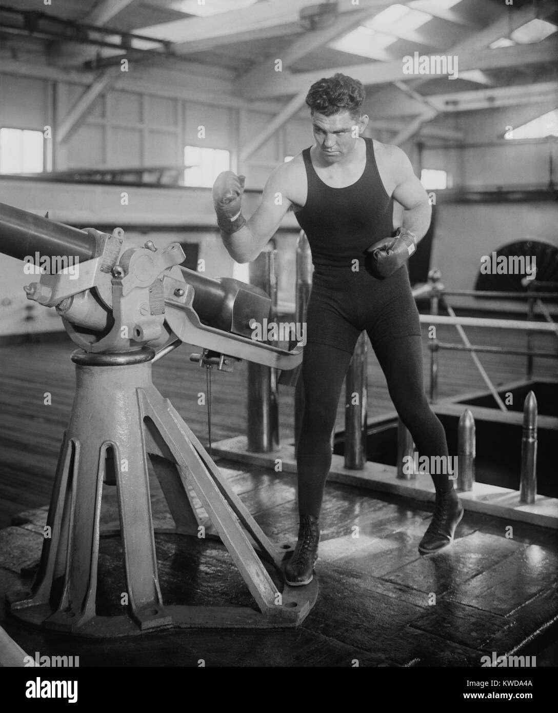 World Champion Boxer Jack Dempsey in fighting pose. Ca. 1920-24. (BSLOC_2015_17_70) - Stock Image