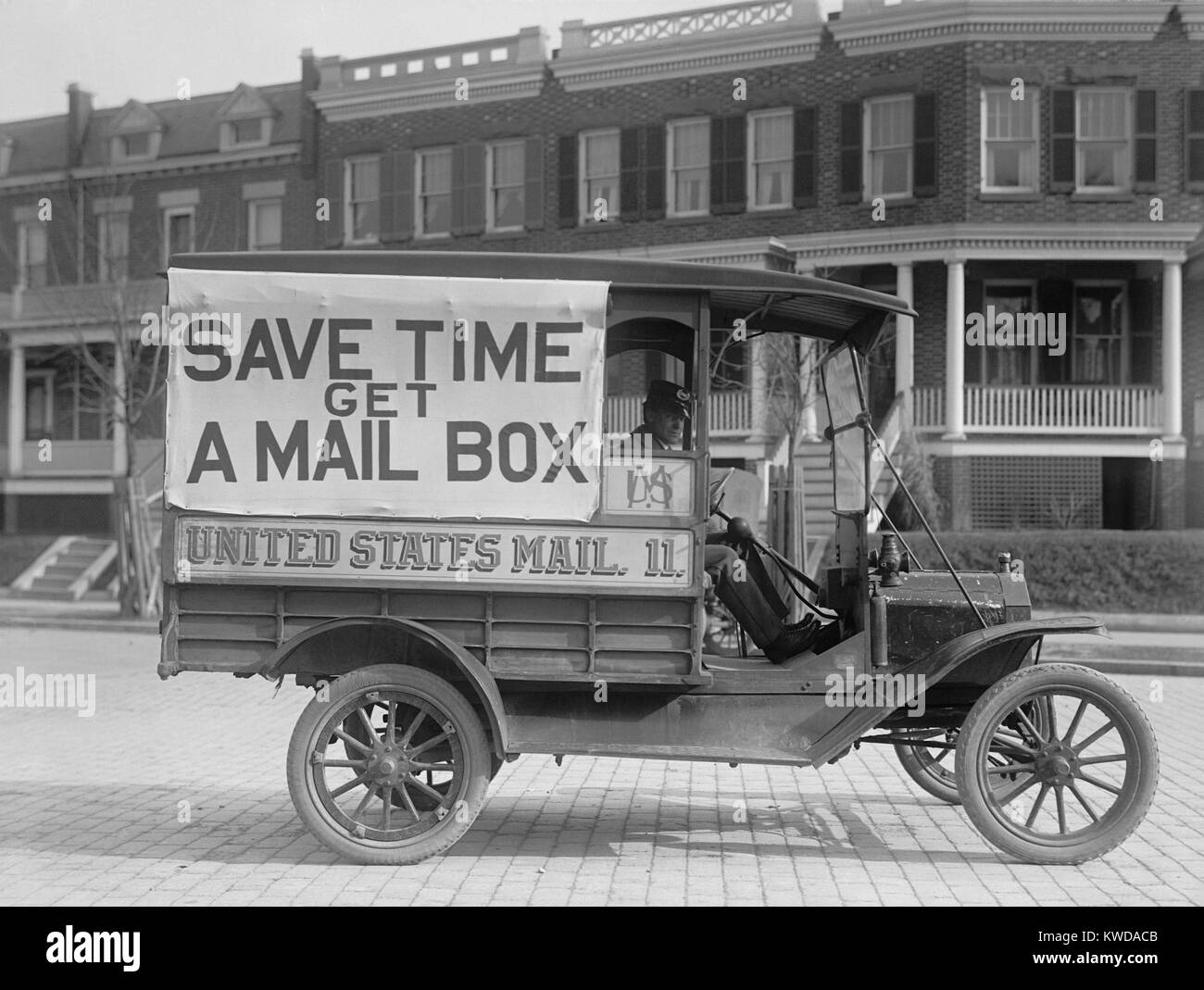 Mail Wagon in Washington, D.C. in 1916. On its side is a large sign encouraging citizens to get mailboxes, allowing Stock Photo