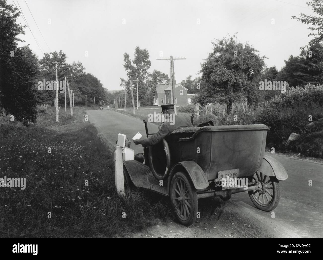 Post man delivering mail in rural, York County, Maine, Aug. 26, 1930. Rural Free Delivery became an official U.S. - Stock Image