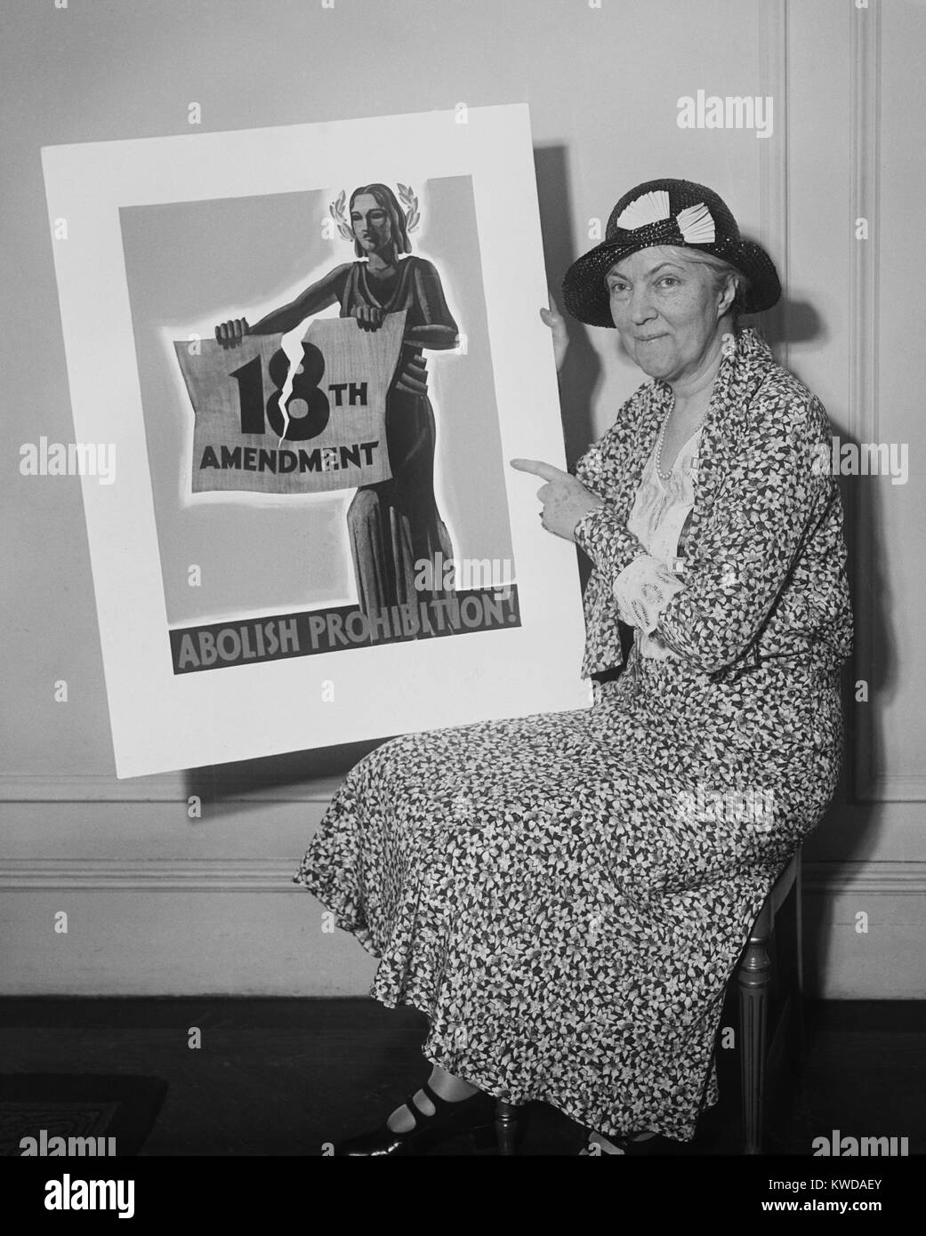 Woman holding a 1931 poster 'Abolish Prohibition!' In 1933 state conventions ratified the Twenty-first Amendment, - Stock Image