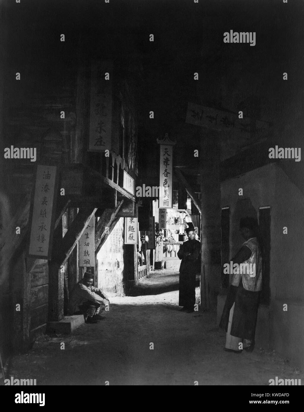 'Neighbors of the Alley', by Paul Grenbeaux. Three Chinese men in a dark alley of Chinatown, in Los Angeles, - Stock Image