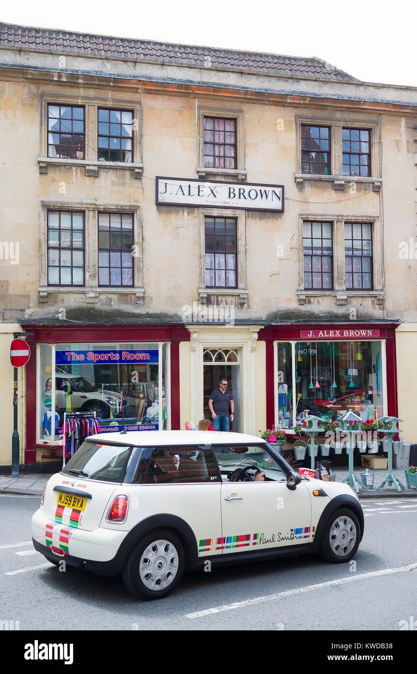 A BMW MINI passes through the historic wool town called Bradford on Avon Wiltshire England UKu - Stock Image