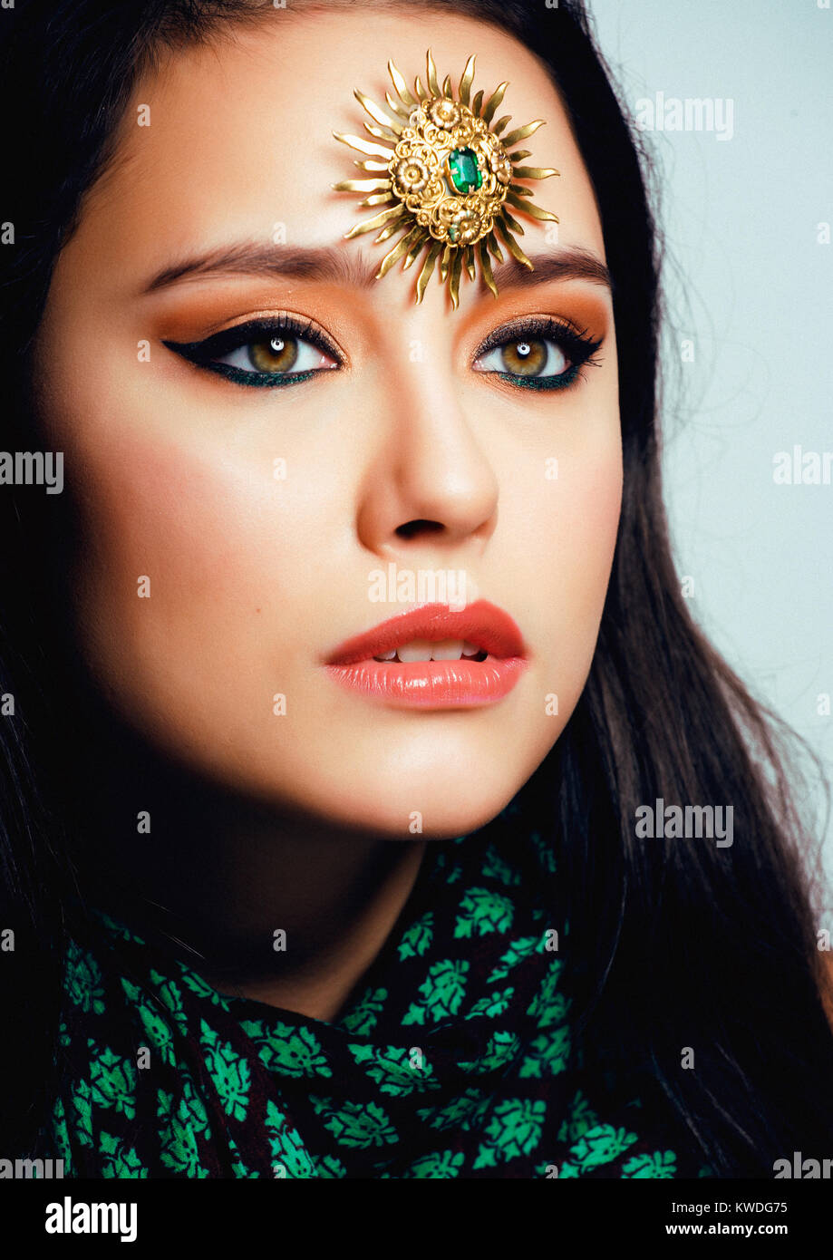 beauty eastern real muslim woman with jewelry close up, bride with star creative makeup, modern art concept - Stock Image