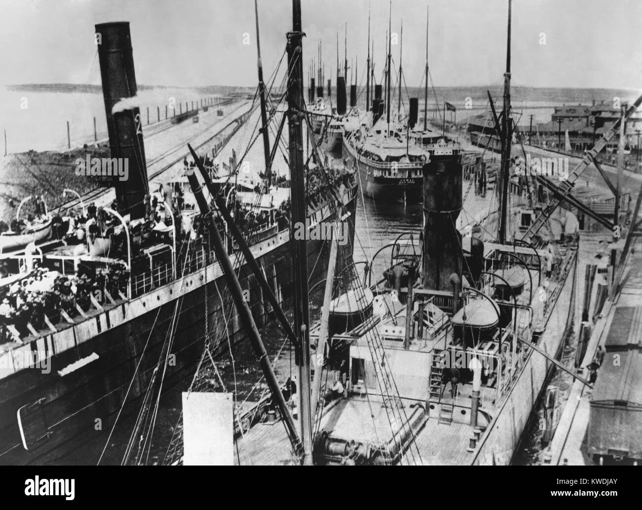 Nine loaded transports moving out into Tampa Bay in June 1898. They were destined for the southeast coast of Cuba - Stock Image