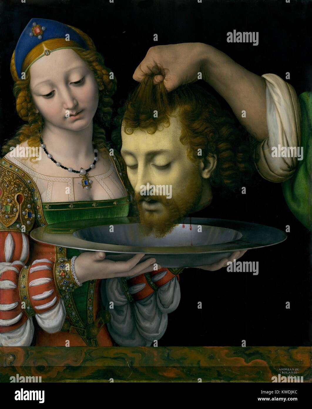 SALOME WITH HEAD OF JOHN THE BAPTIST, by Andrea Solario, 1490-1524, Italian Renaissance oil painting. There is dramatic - Stock Image