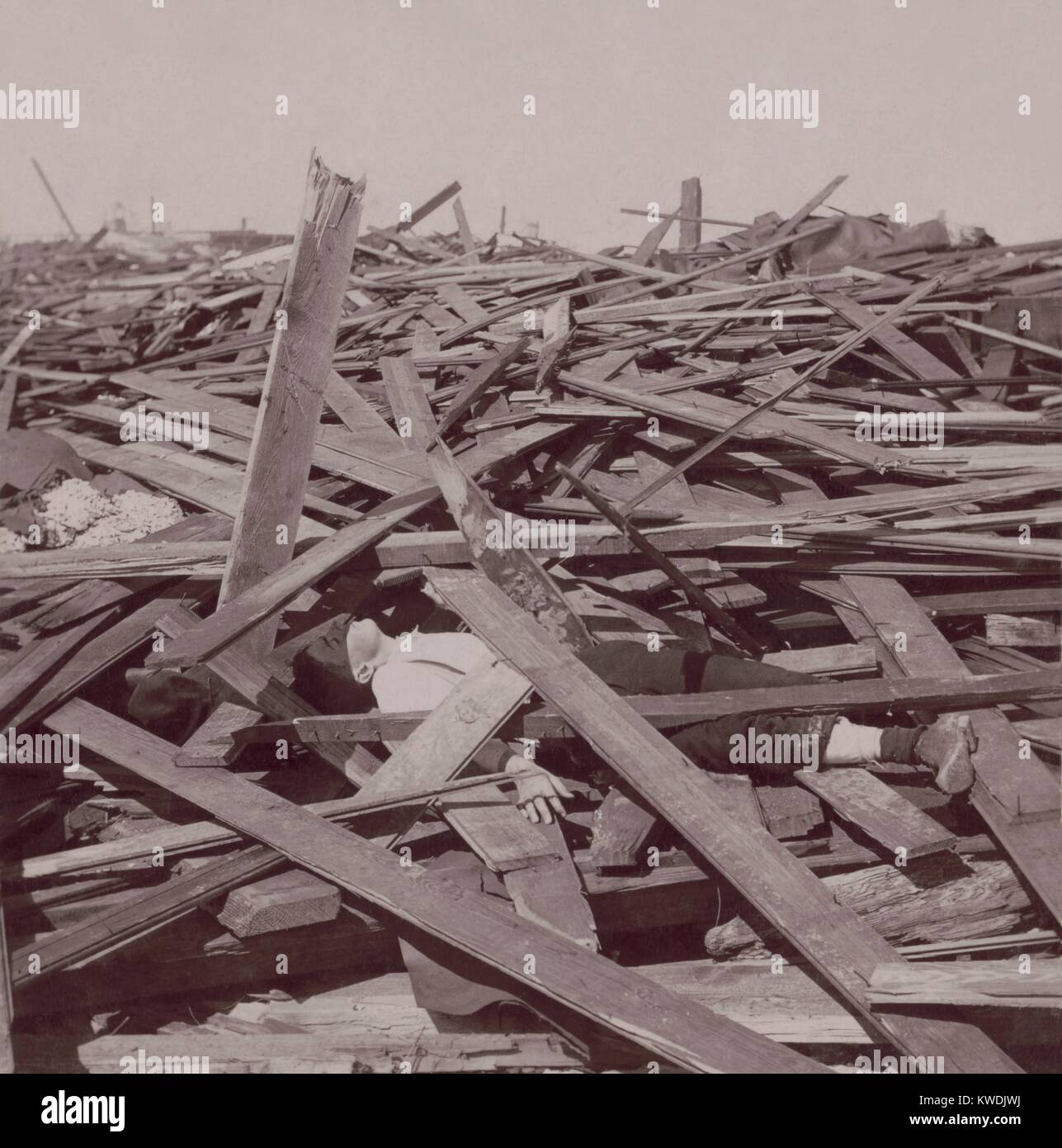 A dead man under wood planks after the Galveston, Texas, hurricane of Sept 8, 1900. 8,000 people are believed killed, - Stock Image