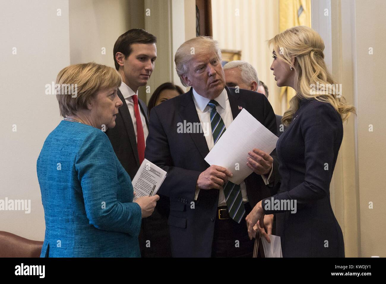 President Donald Trump talks with German Chancellor Angela Merkel, Friday, March 17, 2017. They are joined by Senior - Stock Image