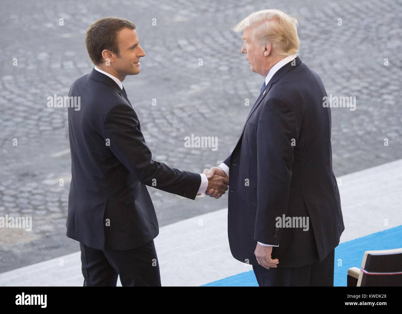 French President Emmanuel Macron welcomes President Donald Trump to the Bastille Day parade in Paris. July 14, 2017 Stock Photo