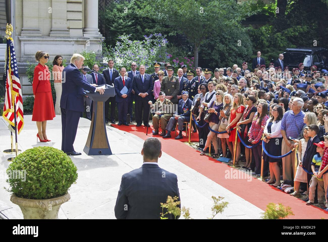 President Donald Trump speaks to service members and veterans in Paris. US soldiers would lead the Bastille military - Stock Image