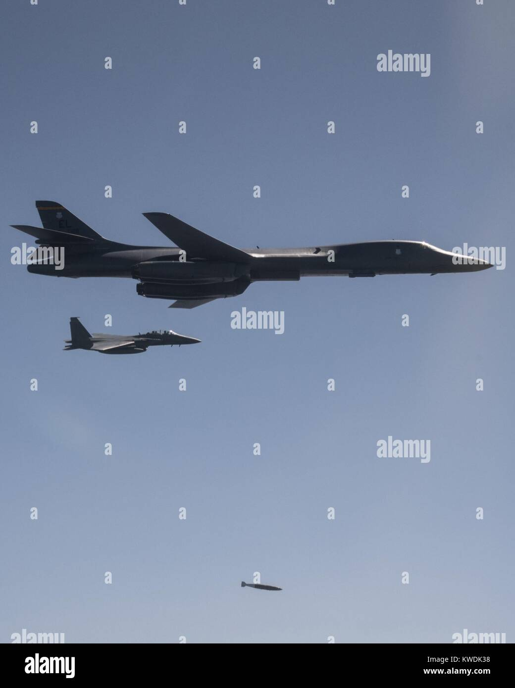 A US Air Force B-1B Lancer drops a 2,000 pound live munition at Pilsung Training Range, South Korea. Flanked by Stock Photo
