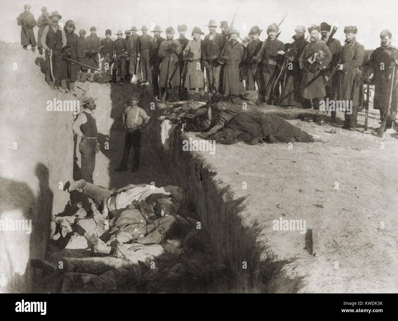 Burial of the Native American victims of the Wounded Knee Massacre, in Jan. 1891. The US Army contracted workers Stock Photo