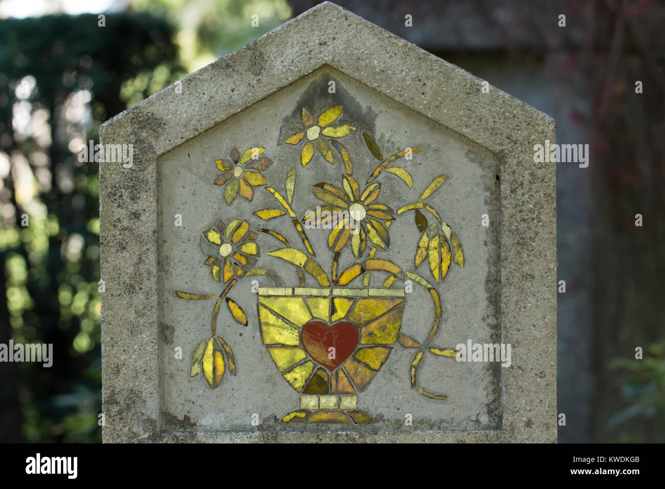 sacred heart of christ, glass, on stone surface Stock Photo