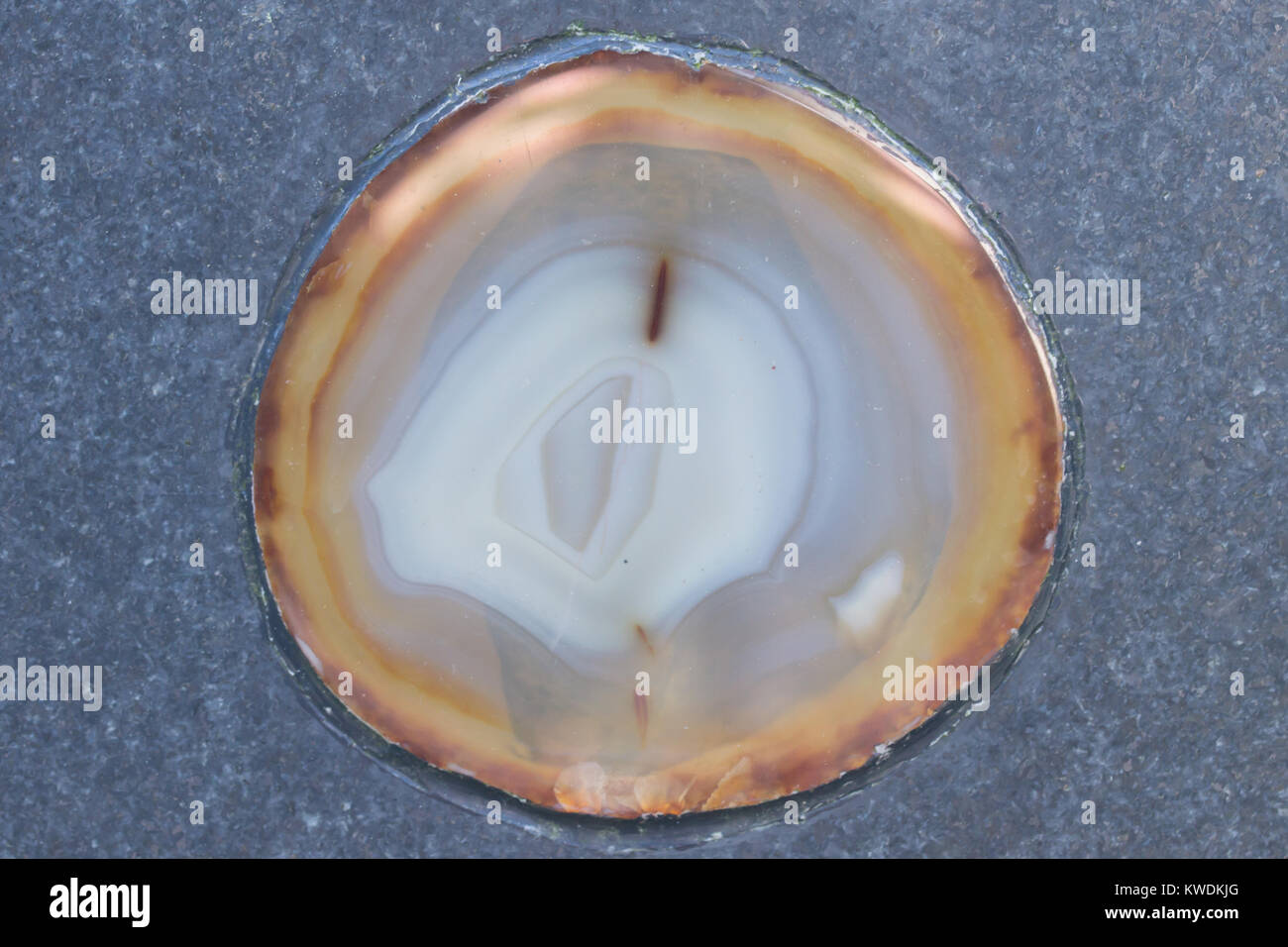 refined round agate mineral inbeded in to  stone - Stock Image