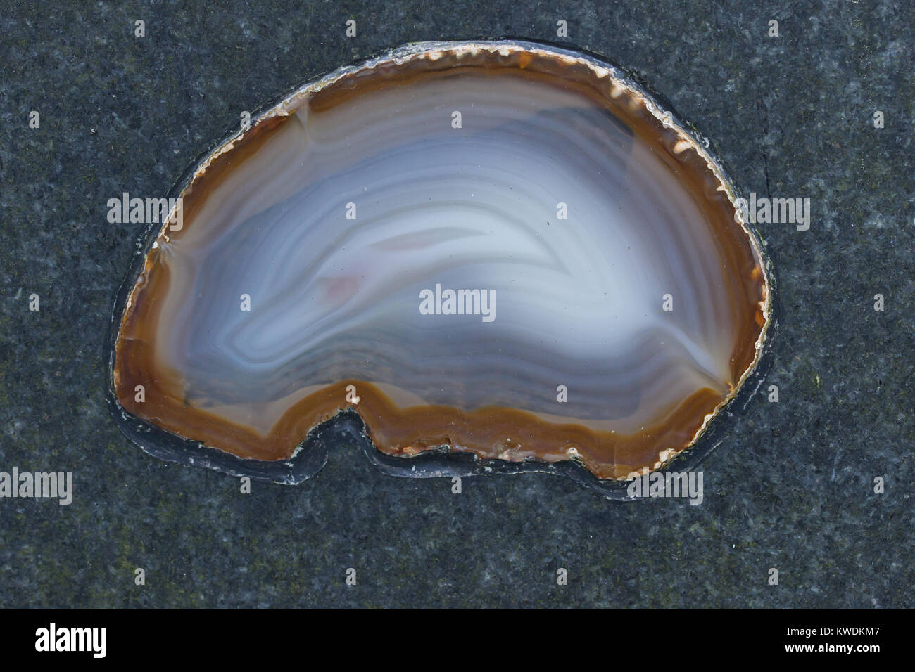 refined agate mineral inbeded in to  stone - Stock Image