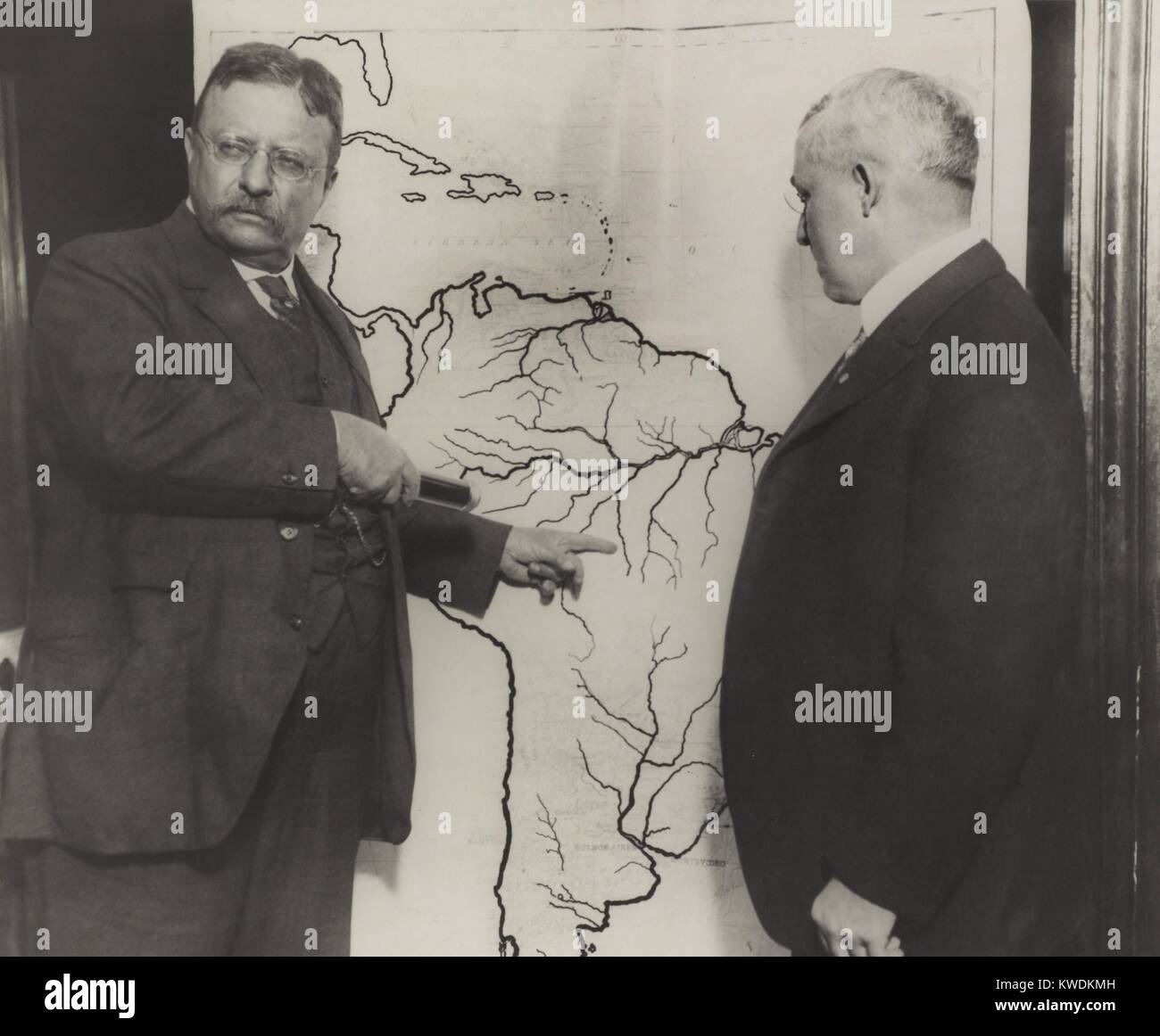 Theodore Roosevelt pointing at the area explored during the Roosevelt-Rondon Scientific Expedition. They explored - Stock Image