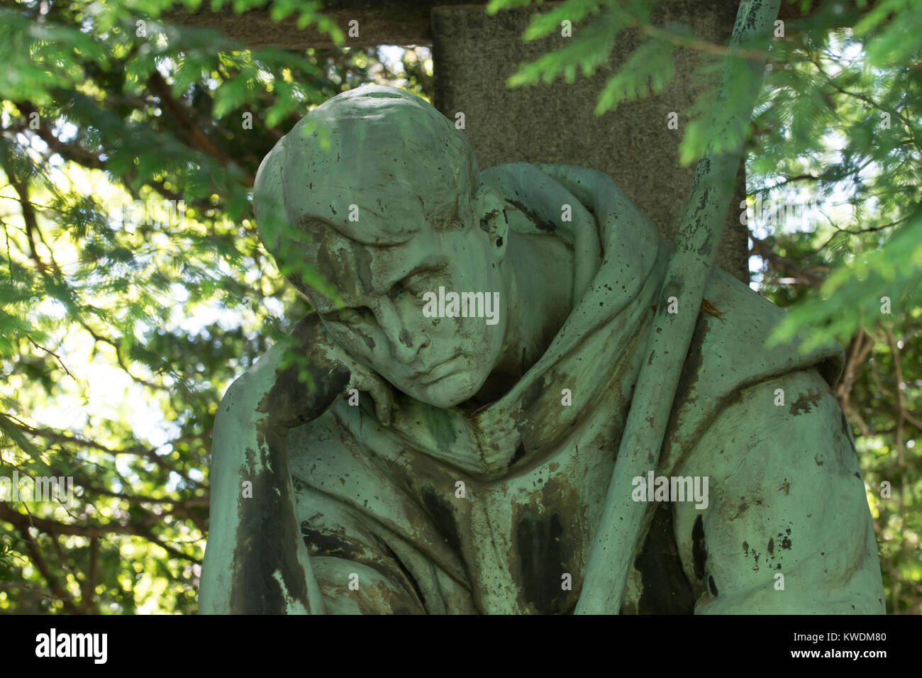 Close up of a sorrowful monk statue. Old catholic cemetery, Dresden, Germany. Stock Photo