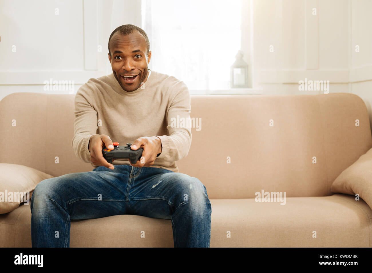Cheerful man playing a game - Stock Image