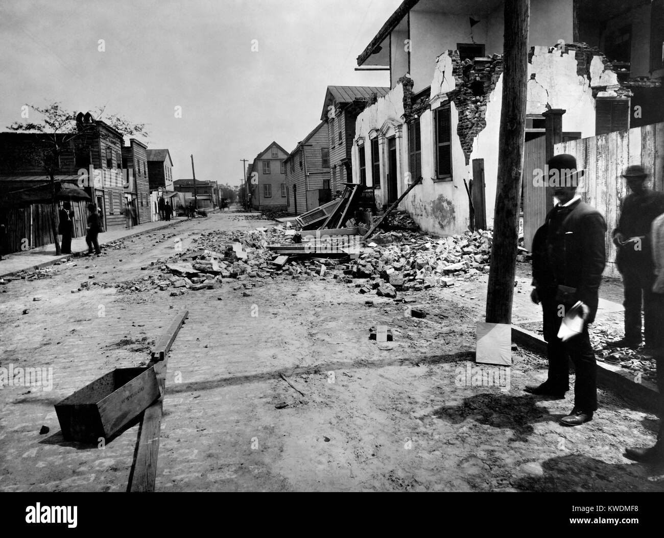 Brick house on Tradd Street, Charleston, damaged by the earthquake of August 31, 1886. William John McGee of the - Stock Image