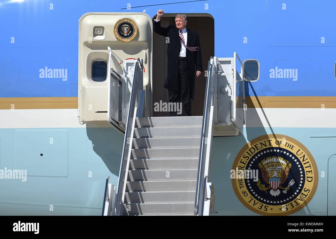 President Donald Trump gives a clenched fist salute from Air Force One, March 2, 2017. On arriving at Langley, VA, Stock Photo