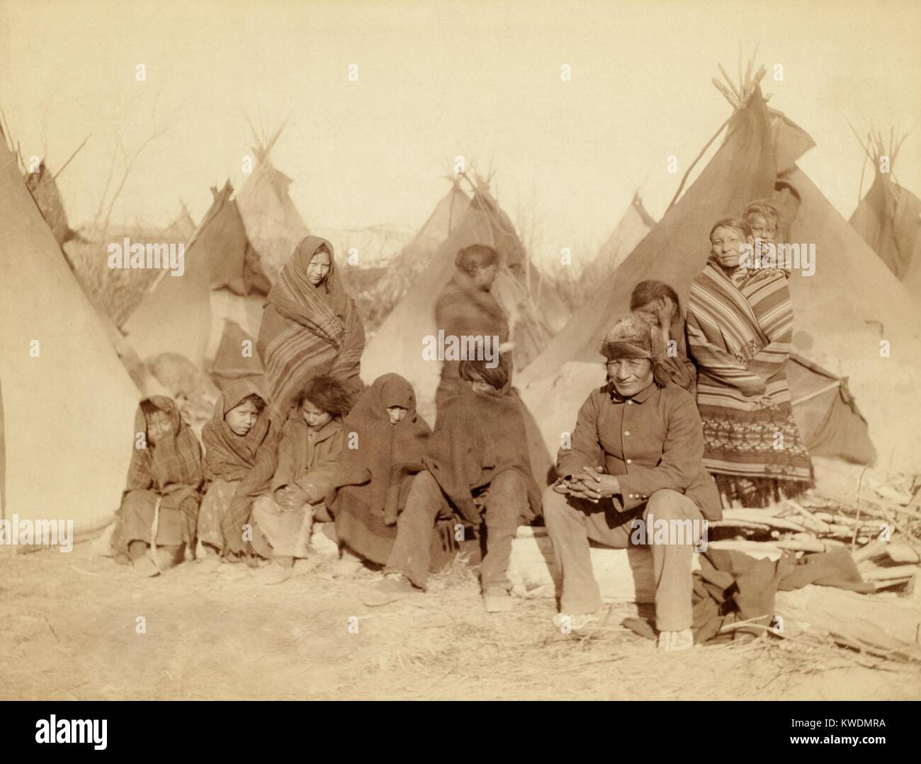 Eleven Miniconjou Lakota (Sioux) in a tipi camp, after the Wounded Knee Massacre of Dec. 29, 1890. They are survivors Stock Photo