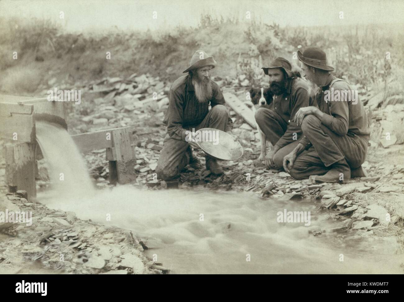 Three men panning for gold in a stream in the Black Hills of South Dakota in 1889. Old timers, Spriggs, Lamb, and - Stock Image