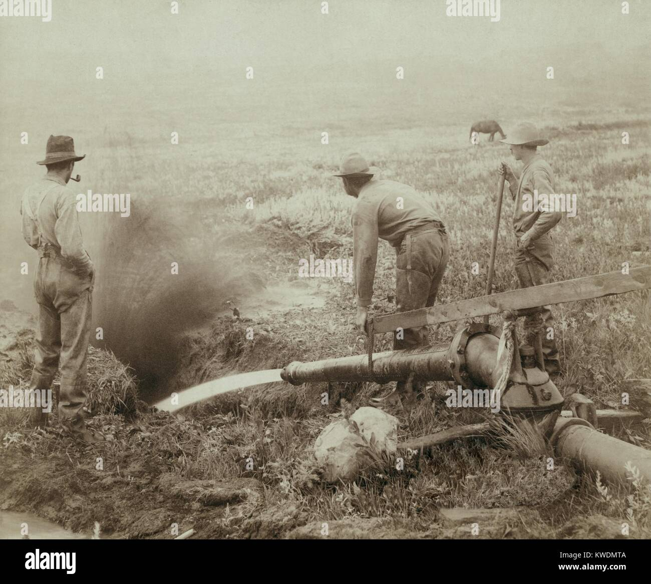 Three men engaged in hydraulic gold mining in Rockerville, Black Hills or South Dakota, 1889 (BSLOC_2017_18_54) - Stock Image