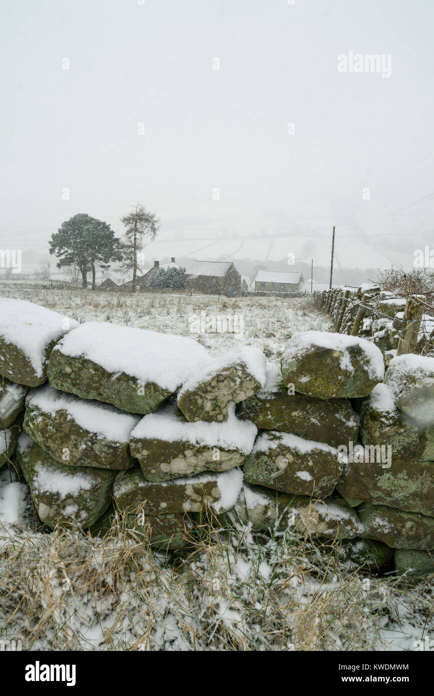 Heavy snow showers at Low Mill moorland village in Farndale North Yorkshire UK - Stock Image