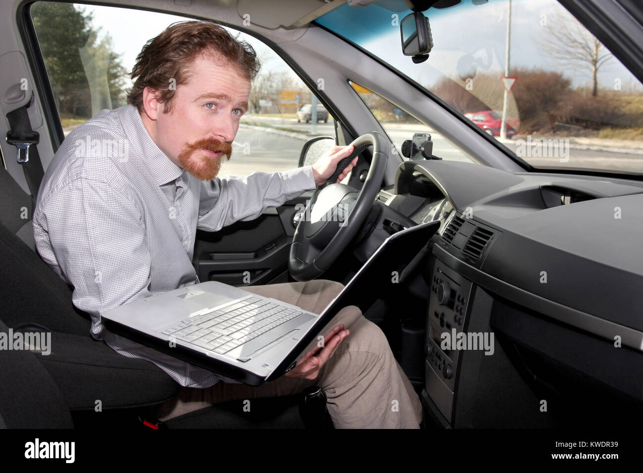 driver using gps laptop computer in a car - Stock Image