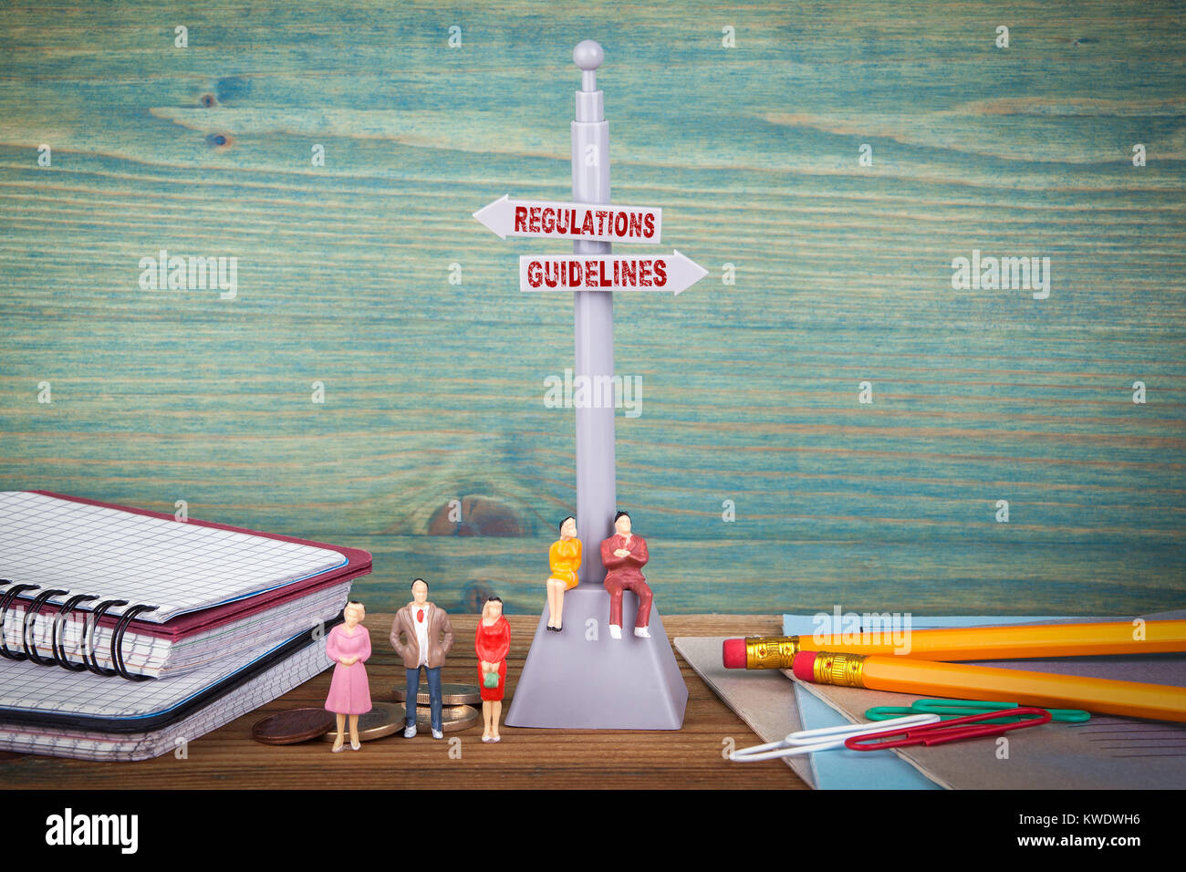 Regulations and Guidelines. Signpost on wooden table - Stock Image