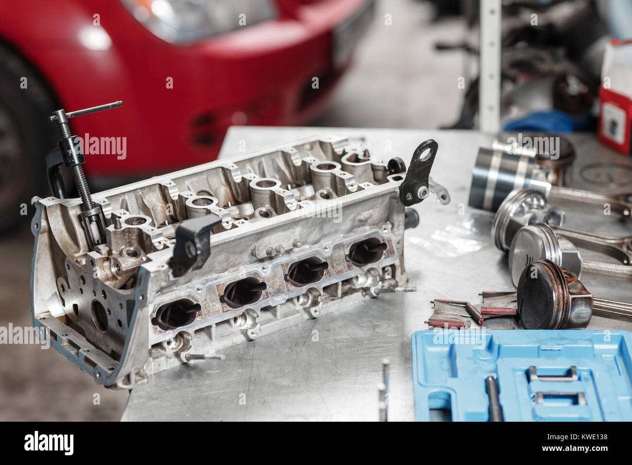 Selective focus. Engine Block on a repair stand with Piston and Connecting Rod of Automotive technology. Blurred Stock Photo