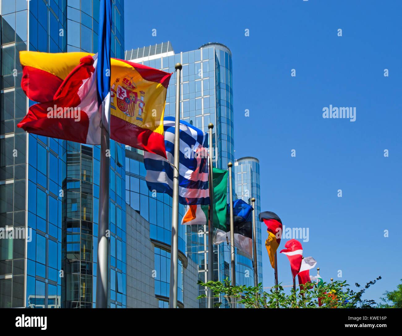 Brussels, Belgium. European Parliament Building - European flags - Stock Image