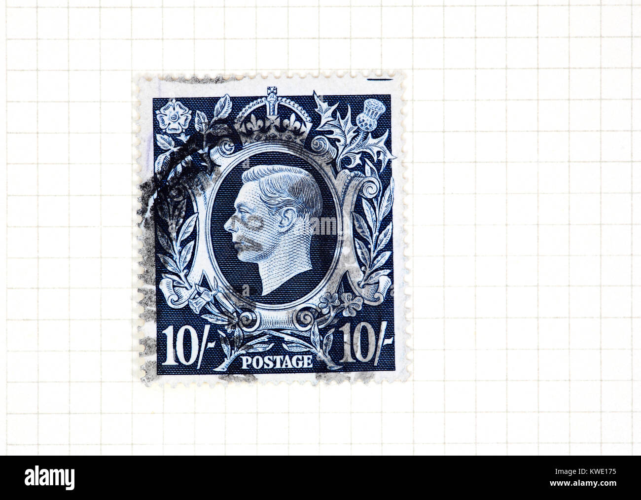 A used King George VI 10s dark blue stamp of 1939-48 issue from a collection of British stamps. - Stock Image