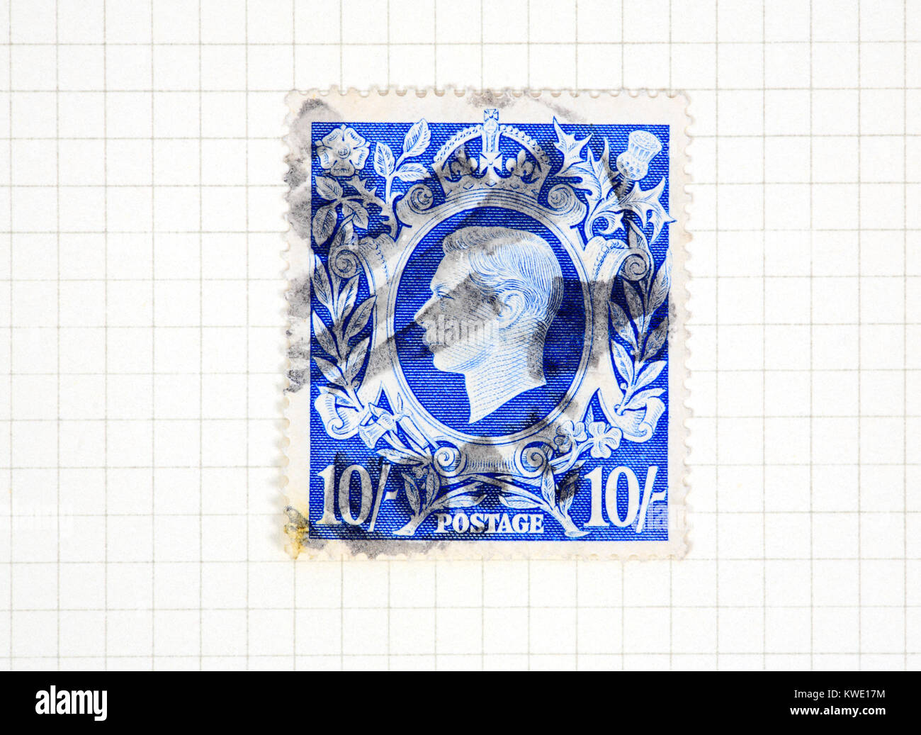 A used King George VI 10s bright blue stamp of 1939-48 issue from a collection of British stamps. - Stock Image