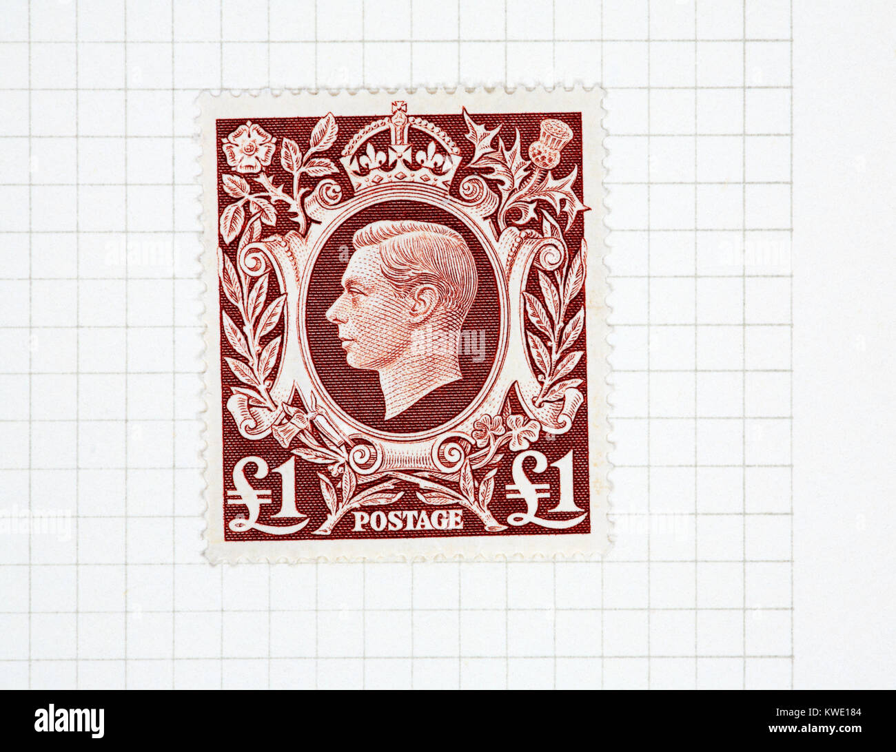 A mint King George VI £1 brown stamp of 1939-48 issue from a collection of British stamps. - Stock Image