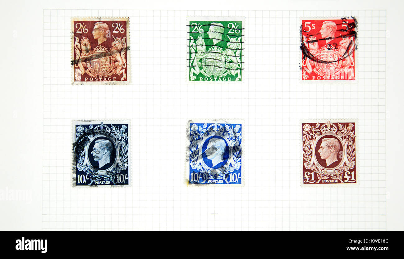 A stamp album page of six high value King George VI stamps of 1939-48 issue. - Stock Image