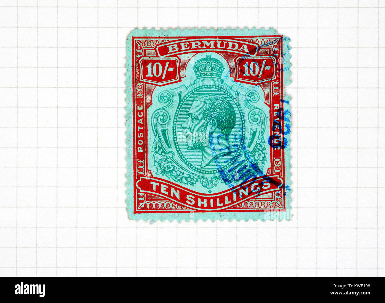 A King George V reign Bermuda Ten Shillings used stamp from a stamp collection album page. - Stock Image
