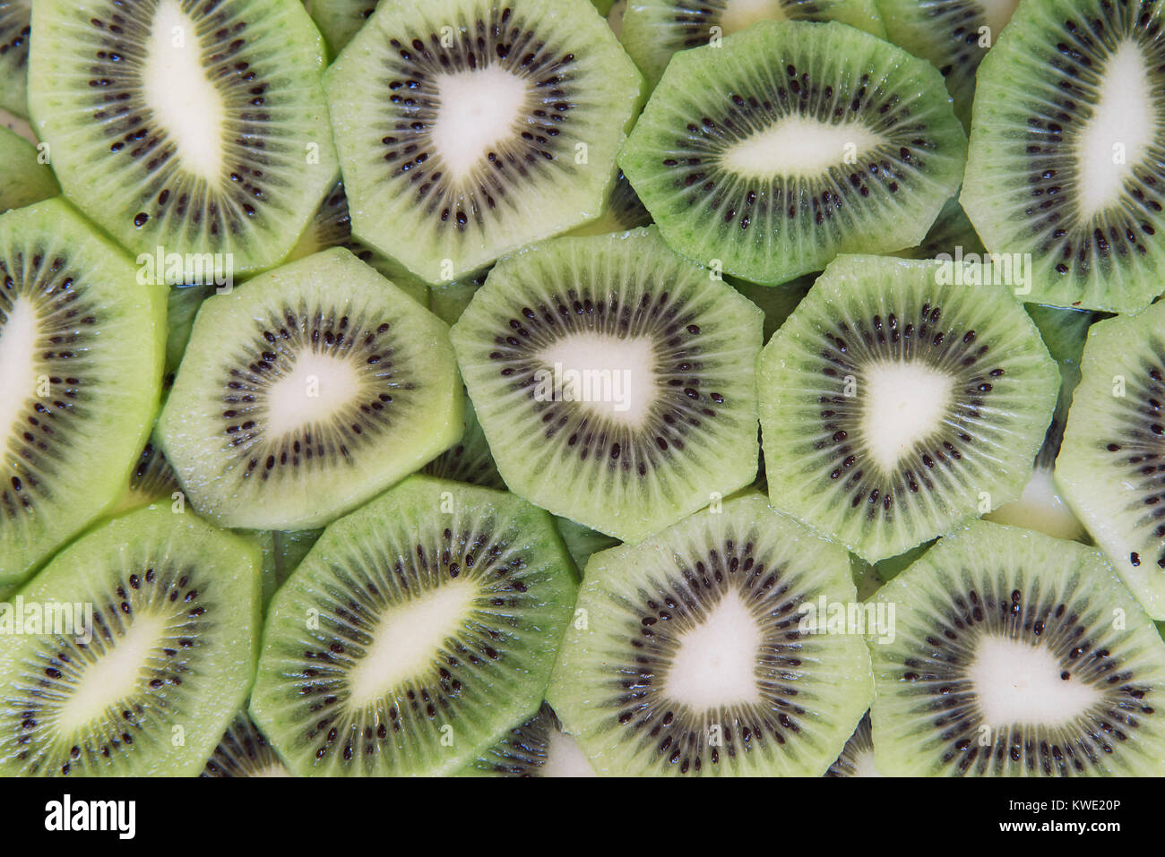 green slices of kiwi fruit texture background Stock Photo