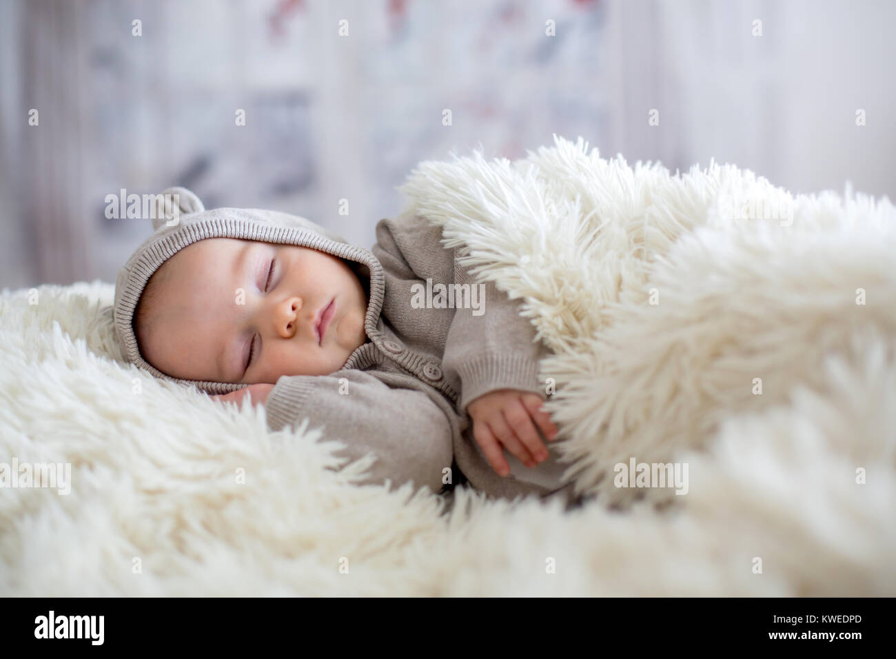 Sweet Baby Boy In Bear Overall Sleeping In Bed With Teddy Bear Stock Photo Alamy
