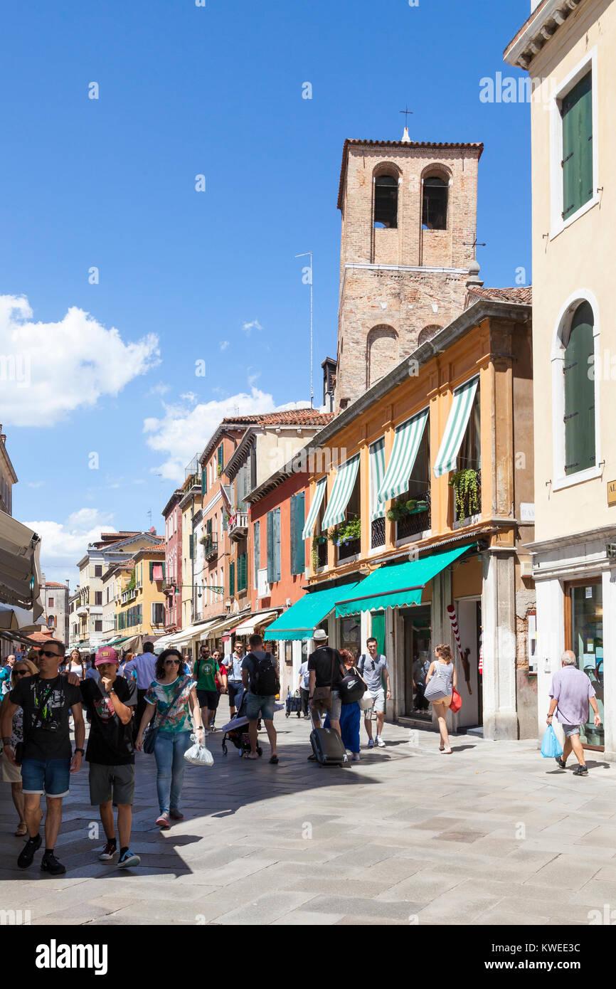 Busy street scene in Strada Nova, Cannaregio, Venice,  Veneto, Italy with Chiesa di Santa Sofia and pedestrians Stock Photo