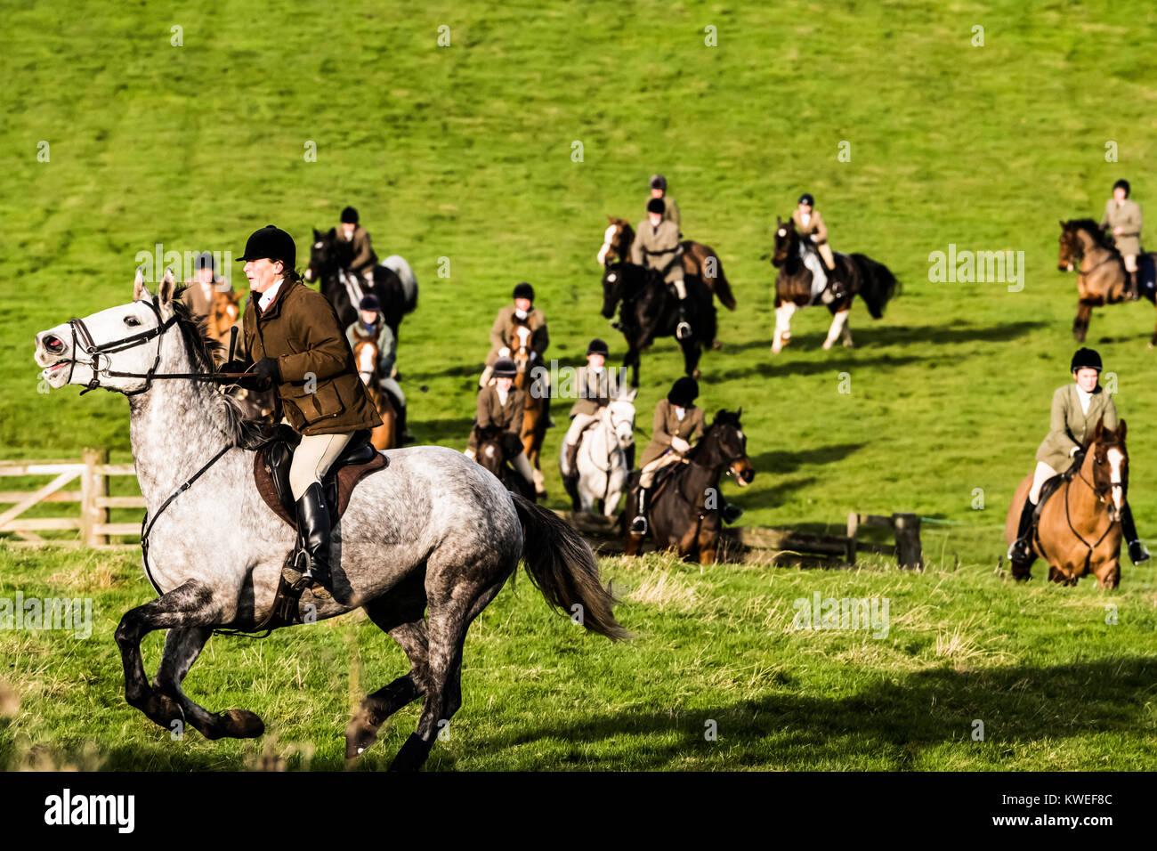 St. Boswells, Scottish Borders, UK. 2nd December 2017. Mounted followers of the Duke of Buccleuch Hunt enjoy crossing Stock Photo