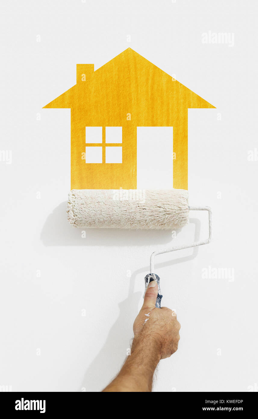 paint roller hand with yellow house symbol painting on wall isolated ...