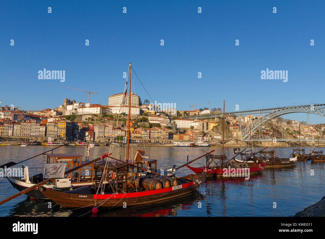 Typical Rabelo boats parked in Douro river in front of Porto city, Portugal Stock Photo