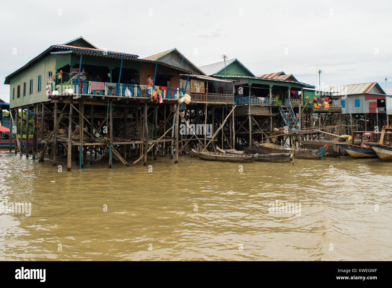 Wood and metal settlement, group of houses buildings on stilts, Kampong Phluk floating village, Tonle Sap Lake, - Stock Image
