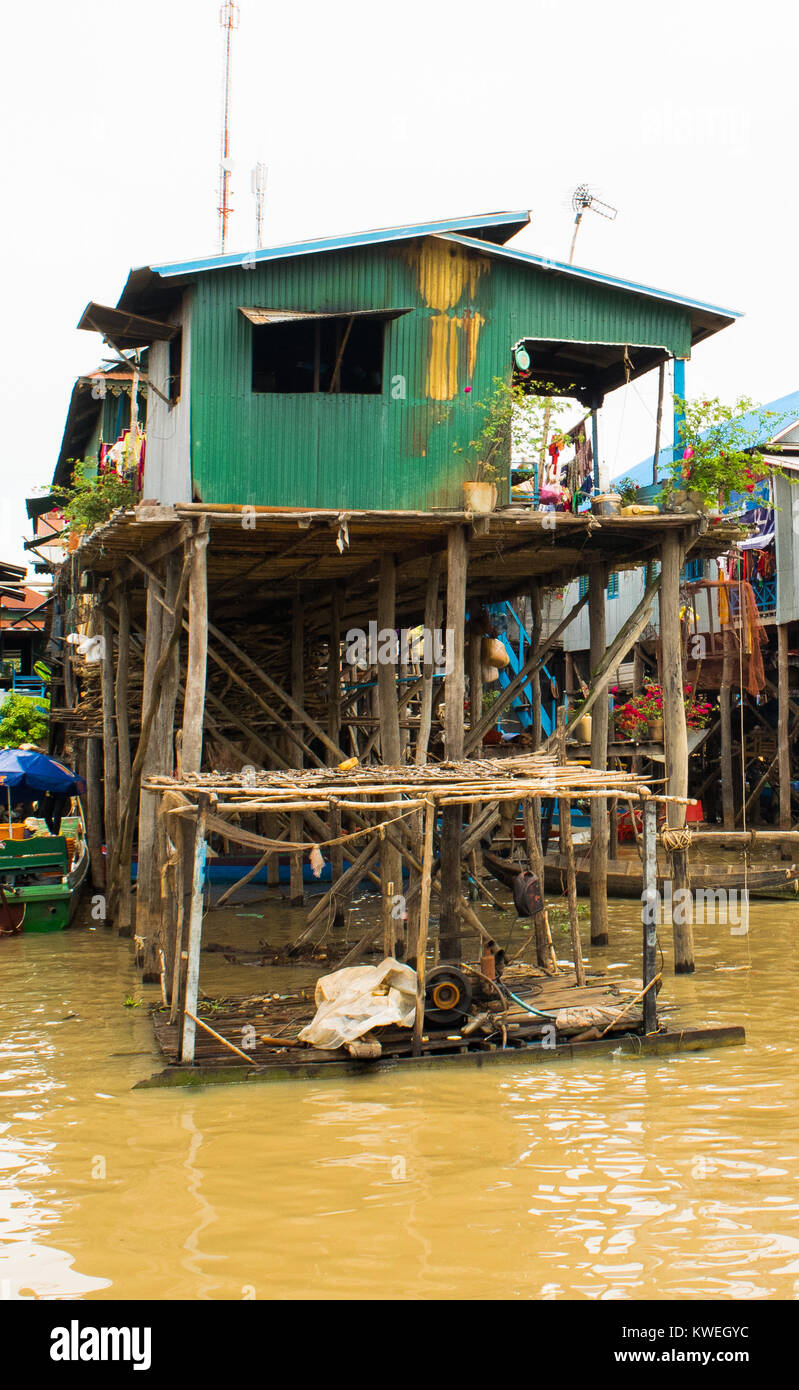 Wood and metal house building flooded drwoned village on stilts, Kampong Phluk floating village, Tonle Sap Lake, - Stock Image