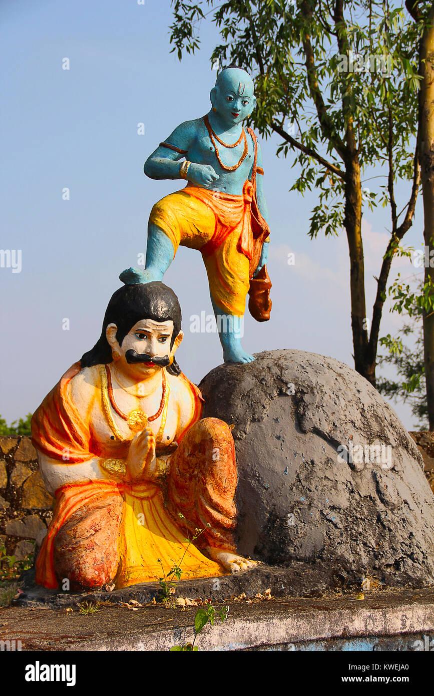 Vaman (fifth avatar of Hindu god Vishnu) holding his leg on Bali, Nilkantheshwar Temple, Panshet, Pune Stock Photo