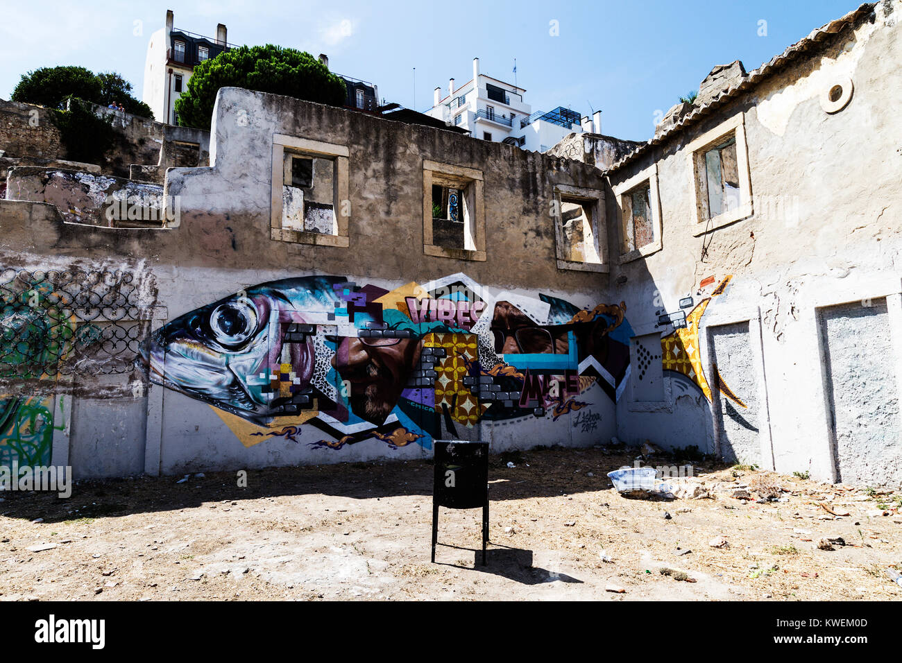 Graffiti ruins near the Saint George Castle in Lisbon. A corner of street art in the upper part of Alfama - Stock Image