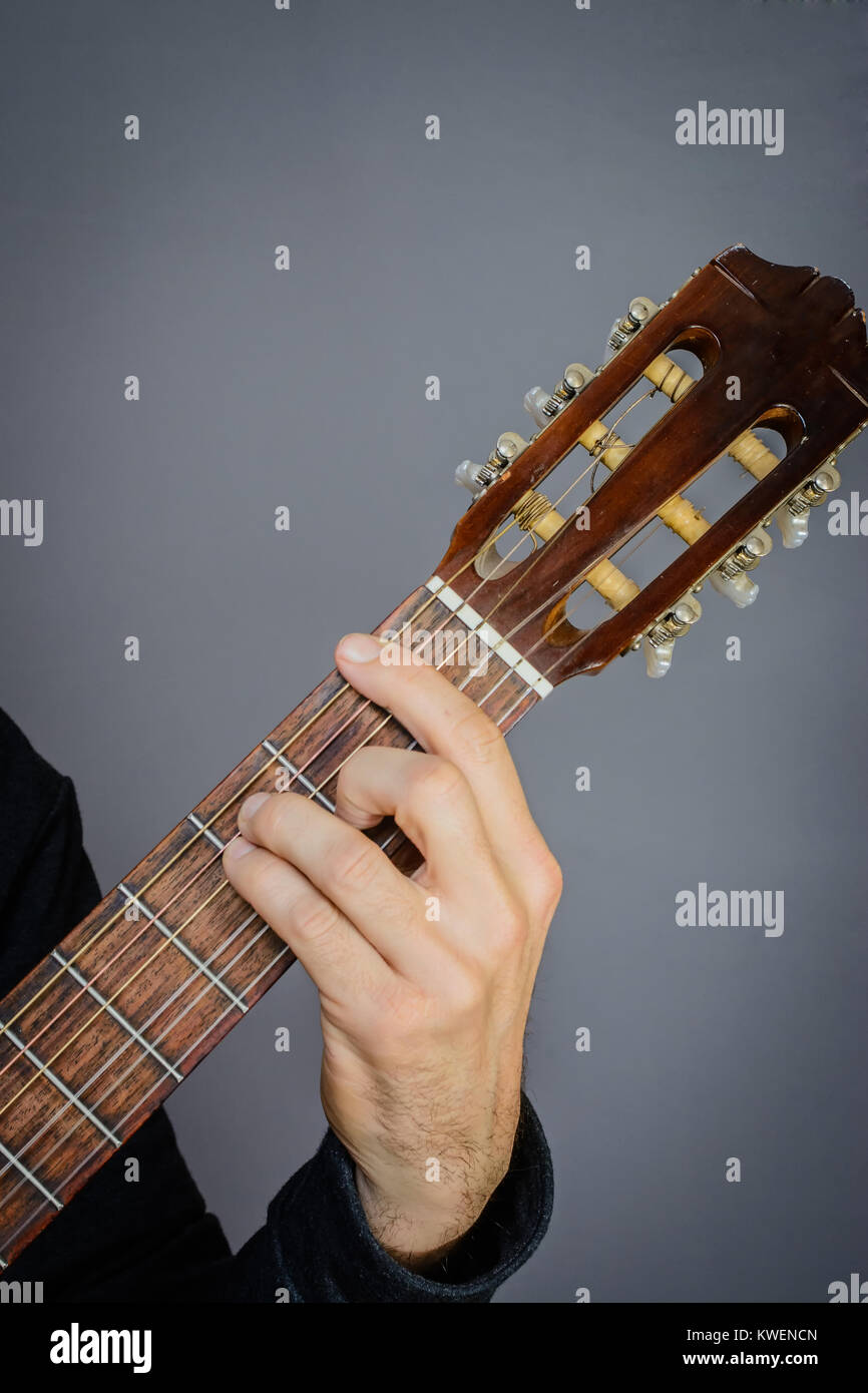 F Chord Stock Photos Images Alamy Open Guitar Diagram Guitarist Playing An Major On Classical Acoustic With Nylon Strings